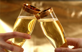 Photo of champagne glasses toasting